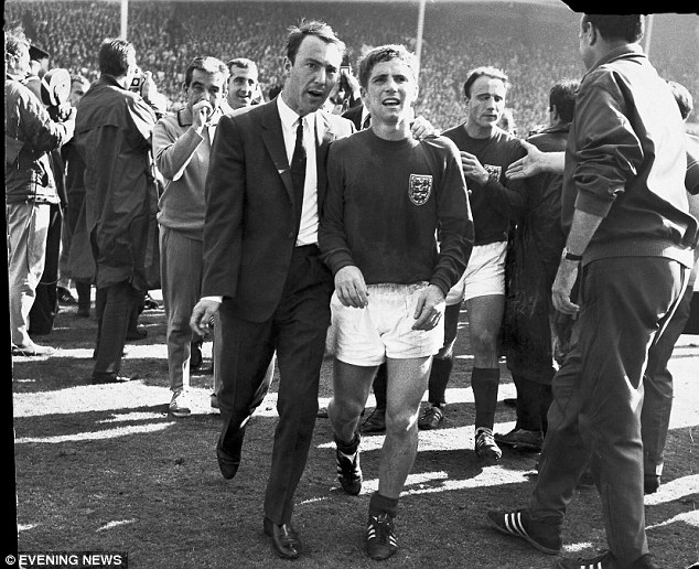 Seize the moment: Alan Ball, pictured alongside Jimmy Greaves (L) after winning the World Cup in 1966 at Wembley, told Sir Alf Ramsey he would not give up his England shirt without a fight