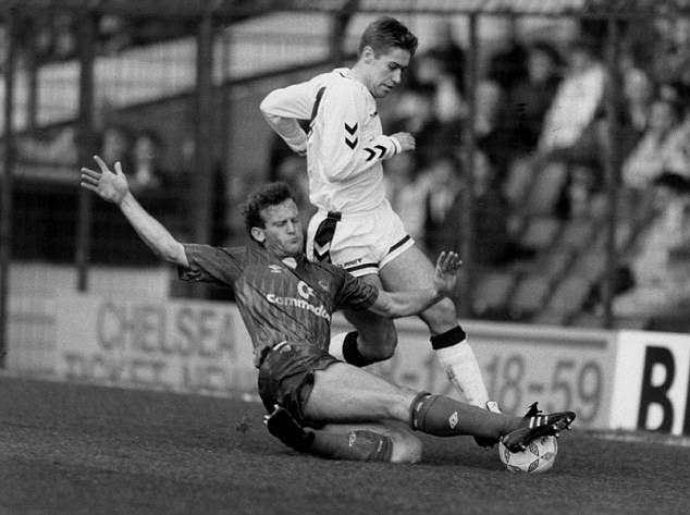 In black and white: Chelsea's Erland Johnsen (left) tackles Tottenham's John Polston during Spurs' 2-1 victory at Stamford Bridge in February 1990 - the north London club's last win at the ground