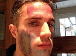 Camouflage: Robin van Persie had his face painted on by his daughter over the weekend
