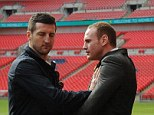 Getting physical: Froch pushes Groves away during the pitch side photo call