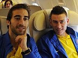 All aboard: Arsenal's Mathieu Flamini and Laurent Koscielny on board the team plane to Munich
