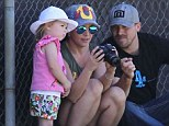 Soccer fan: Jordan watched her big brothers Sean and Jayden on the pitch, while Britney showed her photographs on her camera