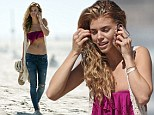 Nothing to hide: Annalynne McCord shows off her minute frame in strapless bikini top and low-riding jeans