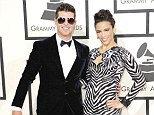 Happier times: Robin Thicke and Paula Patton seemed very much in love at the Grammy awards on January 26