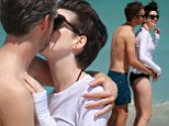 The picture of happiness: Anne Hathaway and husband Adam Shulman can't keep their hands off each other during romantic beach getaway to Miami