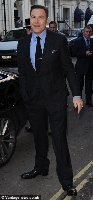 Funny guy: Actor, writer and comedian David Walliams arrives in his trademark suit on Friday