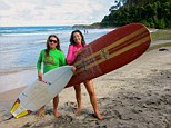All a-board: Lucy, right, and surf instructor Jane get ready to ride the waves