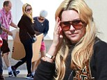 She's Easy A-Okay: Amanda Bynes looks happy and healthy as she picks up boxes from a storage unit with her parents