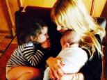 Mommy cuddles: Rachel Zoe tweeted this picture of herself and her children Kaius and Skyler and wrote 'May every morning forever start this way'