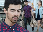 Like an old married couple: Joe Jonas and his girlfriend Blanda Eggenschwiler went grocery shopping at Bristol Farms in Los Angeles on Monday