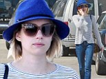 She's all HAT! Emma Roberts tries to keep a low profile in a blue fedora and sunglasses while running errands