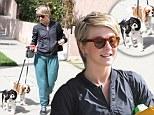 Woman's best friend: Julianne Hough took her fur children for a walk in Los Angeles on Monday