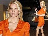 The future's bright! Jessica Simpson shows off her new-found body confidence in a thigh-skimming orange minidress for friend's baby shower