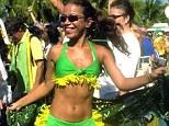 A female fan of the Brazilian soccer team celebrates and dances