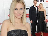 Giving the fans what they want! Kristen Bell cosies up to co-star Jason Dohring on the red carpet at the New York screening of the Veronica Mars movie