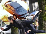 Grant Gustin flies through the air as he escapes car crash explosion on set of upcoming TV series The Flash