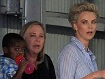She gave Sean Penn a day off! Charlize Theron looks heavily made up as she exits a photo shoot with her mom and son in tow... as boyfriend is nowhere in sight