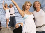 A sensationally Sandy shoot: Grease star Olivia Newton-John and daughter Chloe Lattanzi pose for pictures on a beach