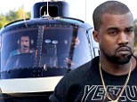 Kanye West does some self-promotion on his day off as he enjoys helicopter tour of Rio de Janeiro in a Yeezus T-shirt