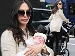 Time for a new post-pregnancy wardrobe! Lauren Silverman pushes baby Eric in his pram as she checks out designer stores with army of female pals