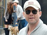 The honeymoon phase isn't over! Christian Slater, 44, and new wife Brittany Lopez, 26, spotted sharing a smooch while out with their dog in New York
