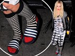 Rita Ora heads out in socks and sandals