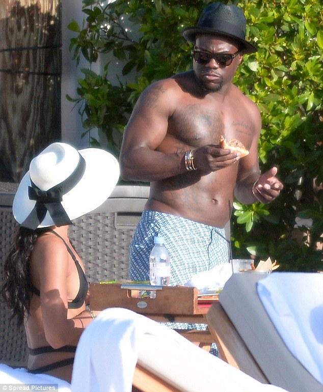 Looking fit: The 34-year-old comedian was looking quite toned as he conversed with his girlfriend Eniko Parrish