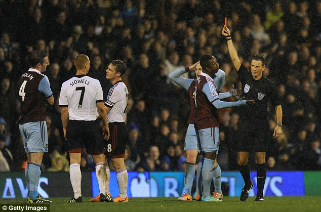 Seeing red: Kevin Nolan was sent off just before half time for kicking out at Fernando Amorebieta