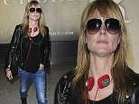 Flying business casual! Heidi Klum goes rocker chic in leather jacket, jeans and sneakers while arriving at Heathrow