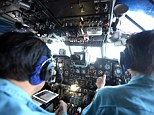 Military officials inside a Soviet-made AN-26 of the Vietnam Air Force during the search and rescue operations for the missing Malaysia Airlines flight