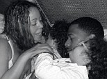 One happy family! Mariah Carey shares intimate photos of her makeup free as she relaxes in bed with Nick Cannon and twins