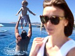 'Fly baby!' Giuliana Rancic's son Duke enjoys a game of toss in the pool with dad Bill during family getaway to Mexico