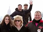 Photobombs away! Jimmy Fallon and Jon Hamm jump behind unsuspecting New York tourists for laughs on The Tonight Show