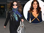 All wrapped up! Salma Hayek keeps her gorgeous figure completely covered as she arrives in London