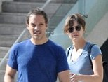 Back together? Katharine McPhee was pictured with her husband Nick Cokas in Los Angeles on Monday, for the first time since she was seen kissing another man