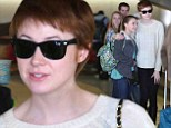 The girl who waited... for a photo! Karen Gillan poses with fan after arriving in LA sporting skinny jeans and cosy jumper