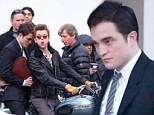 Rough ride! Robert Pattinson looks worried as he sits on motorcycle pillion behind co-star Dane DeHaan while filming Life