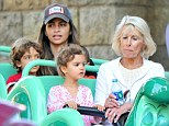 On the rides: The McConaughey family ride on the Alice in Wonderland roller coaster in Disneyland