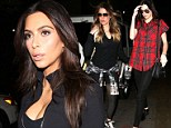 2578028 Tinsel town bikers! Kim Kardashian is joined by sidekicks Khloe and Kendall as she attends spin cycle fitness class