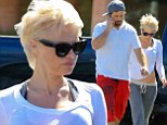 Hard to stomach! Pamela Anderson flashes her navel as she goes for a stroll with husband Rick Saloman