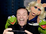 What a Muppet! Ricky Gervais was determined not to let Miss Piggy hog the spotlight as he snapped selfies at the Muppets Most Wanted Los Angeles premiere on Tuesday night