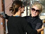 Hugging it out: Nikki Reed gave her friend Julianne Hough a meaty embrace in Los Angeles on Tuesday