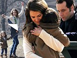 Now THAT'S multi-tasking! Keri Russell cuddles daughter Willa and teaches her to fly a kite whilst on set of The Americans