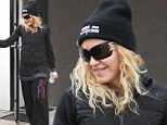 Did you need a lot of Material Girl? Madonna emerges from Pilates class wearing baggy workout gear