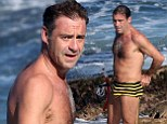 Andrew O'Keefe makes waves at Bondi as he hits the pool in a pair of bumble bee budgie smugglers