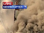 Engulfed: The apartment building on the corner of 116th and Park burst into flames around 9am this morning