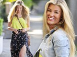 Sunny delight: Amy showed off some leg in a floral skirt complete with a thigh-high split