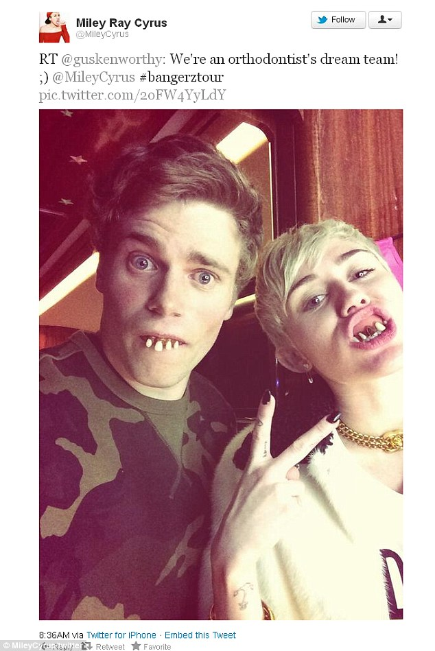We're an orthodontist's dream team! Miley Cyrus and Olympic skier Gus Kenworthy backstage at her Bangerz tour on Tuesday night