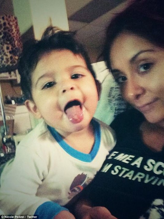 Big fan: Meanwhile Snooki has revealed on Twitter how his son is a huge Miley Cyrus fan after sticking his tongue out for a photo