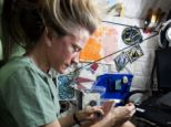Karen Nyberg, an American mechanical engineer and Nasa astronaut. does some sewing while onboard the ISS